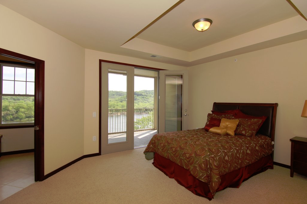 Wisconsin luxury waterfront condos for sale between madison and the wisconsin dells Balcony in master bedroom